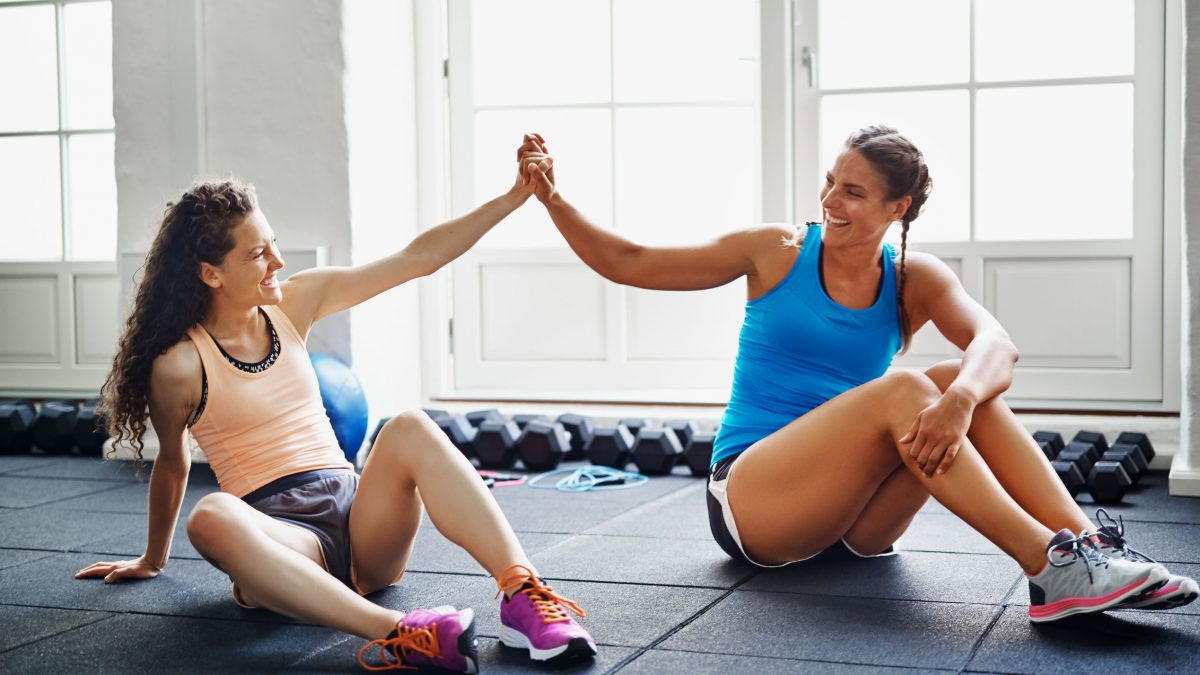 Exercising with a friend has tons of benefits to get you working in the gym.