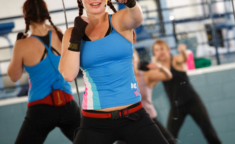 Body Combat was created by Les Mills as a non-contact workout featuring self-defense moves from martial arts such as tai chi, karate, boxing, and kickboxing.