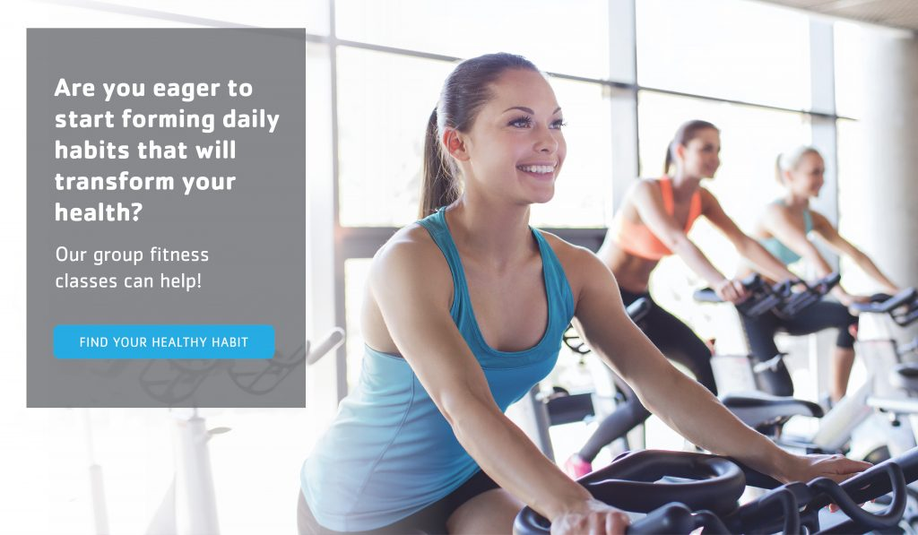 woman on a bike during a group fitness class