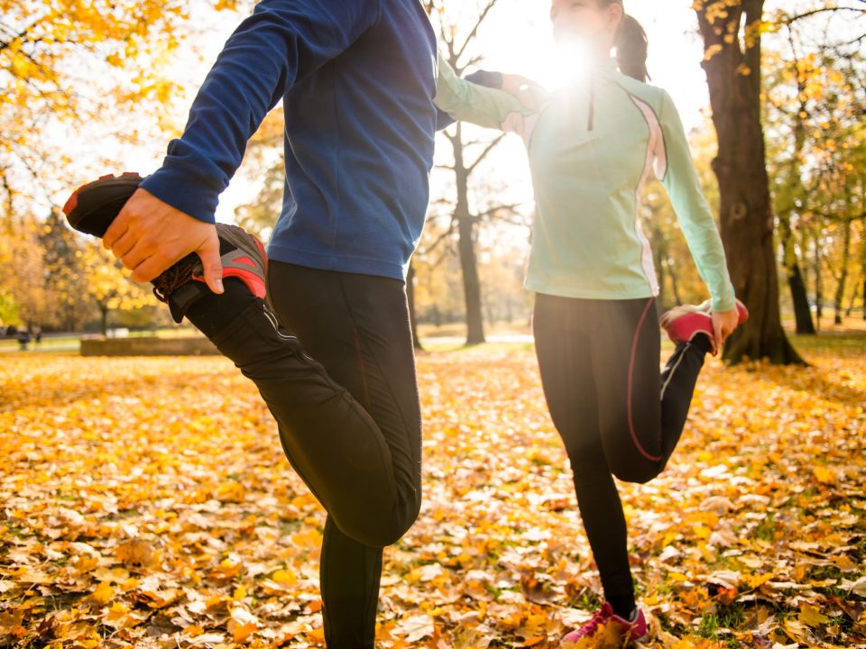 Couple enjoying new ways to exercise in the fall.