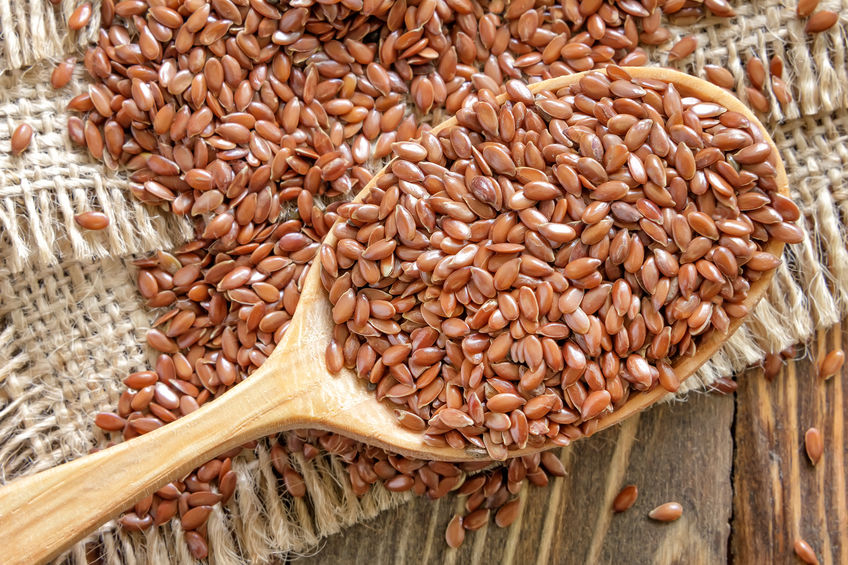 flaxseeds on a spoon and table