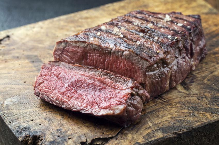 sirloin steak on a wooden plank