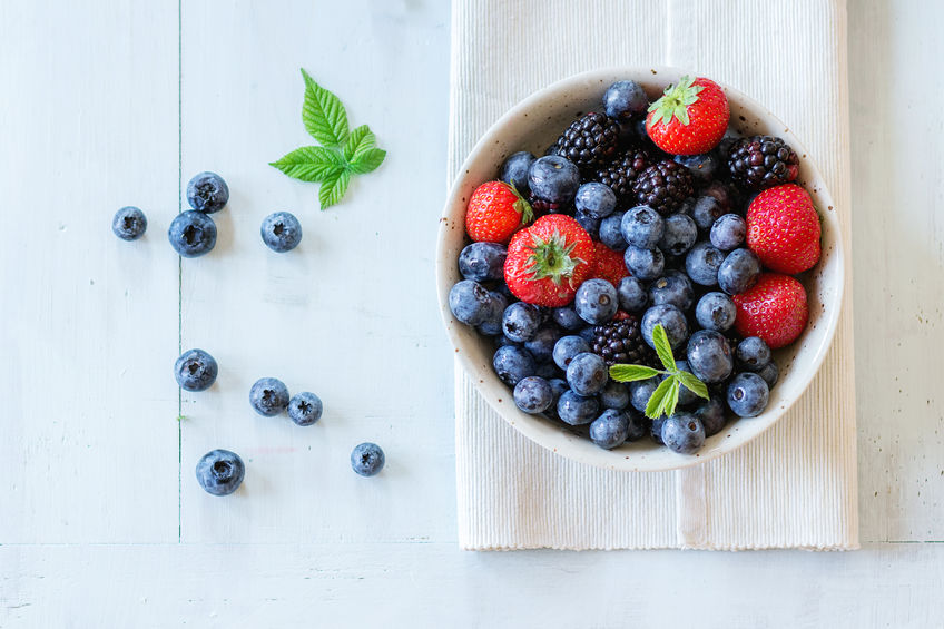 blueberries, blackberries, and strawberries in a white bowl