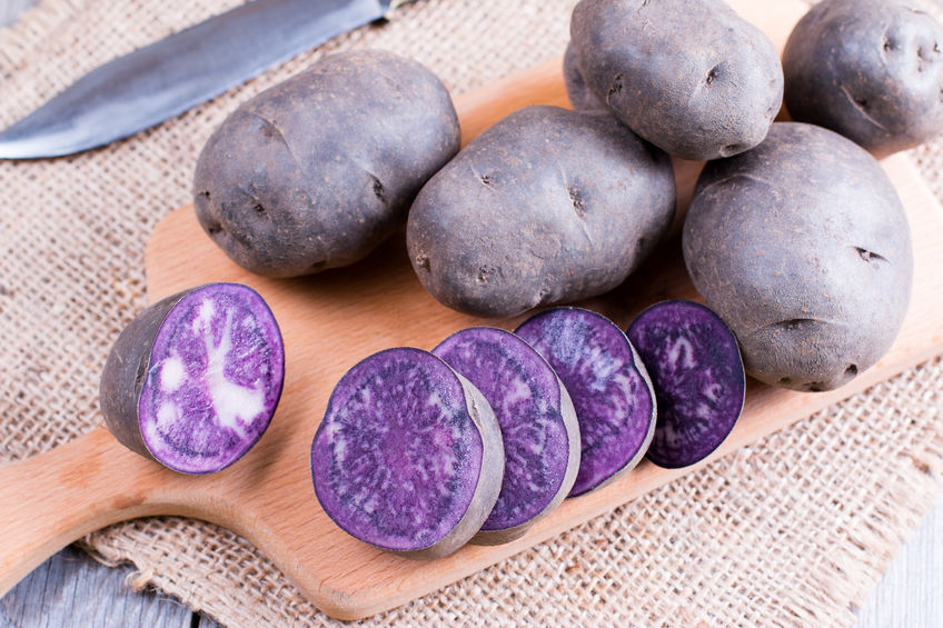 purple potatoes on a wooden table