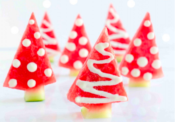 Christmas trees made out of watermelon triangles, rinds for the trunk, and yogurt for decoration