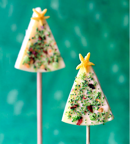 Christmas trees made from cheese wedges, shaved broccoli florets, chili pepper flakes, and yellow pepper (for the star)