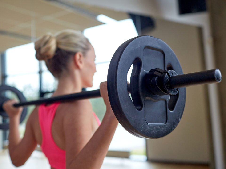 a woman lifting weights at the gym